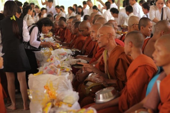 Worshipers presenting their gifts to the monks.
